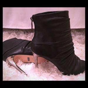 BeBe black leather Bootie w/ silver heel